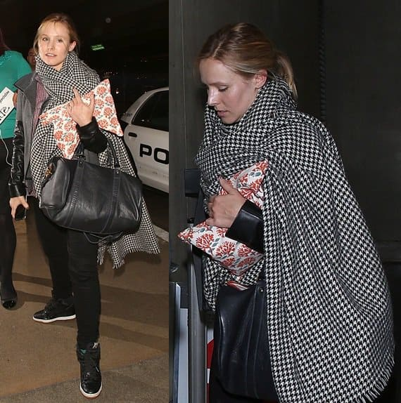 Kristen Bell looks tired after arriving at LAX from a long flight on November 6, 2013