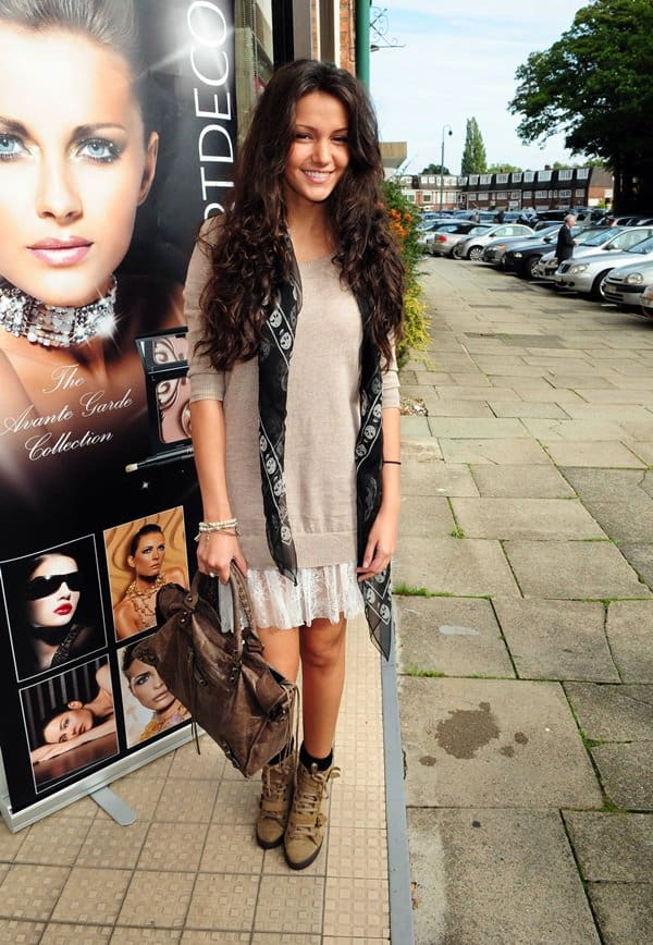 Michelle Keegan wears the skull scarf with a slouchy sweater and lace skirt while heading to Hoopers Department Store in England on October 2, 2010