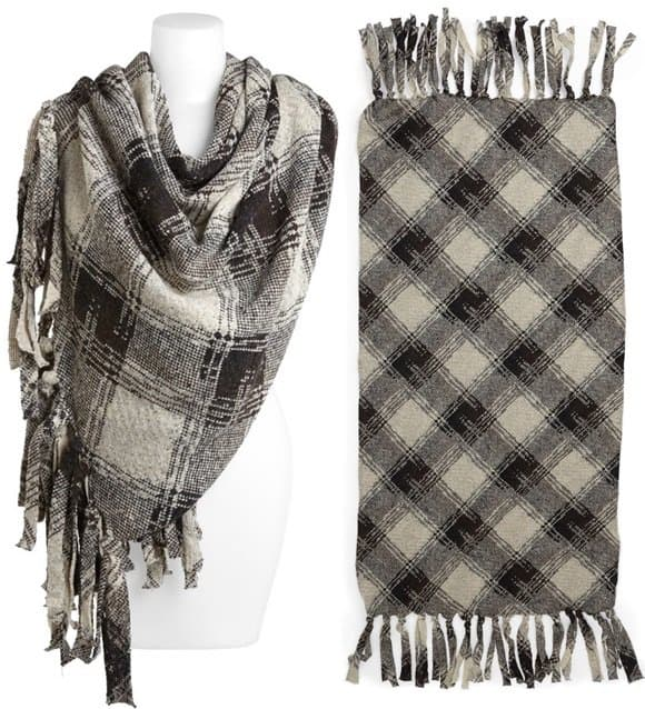 Wide fringe brings a homespun feel to a classic plaid wrap crafted in Italy