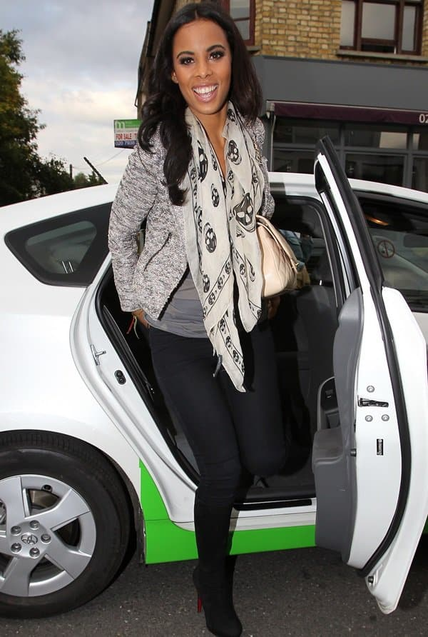 Rochelle Humes of The Saturdays adds polish to her look by capping it off with a textured blazer