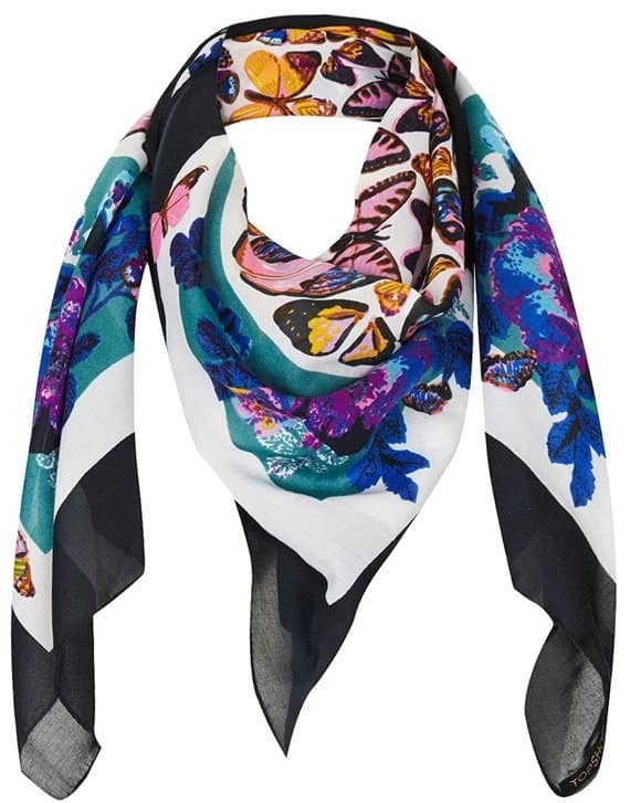 Ethereal butterflies flutter across a wispy square scarf framed in bold contrast borders