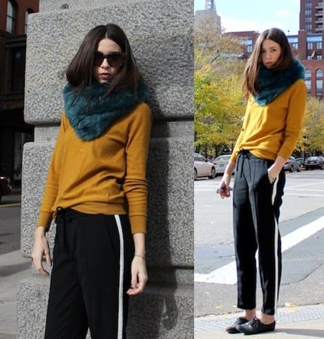 Emily Lane wears her green scarf with a bright mustard sweater as she keeps the rest of our outfit in classic black