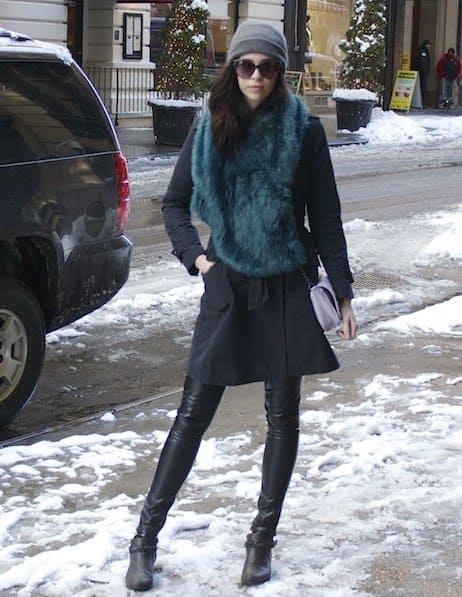 Fashion blogger Emily Lane sporting a green fur scarf with her all-black outfit