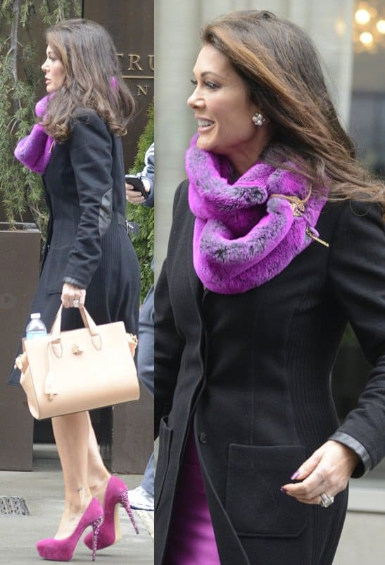 Lisa Vanderpump styled a purple dress with a matching scarf and a black coat