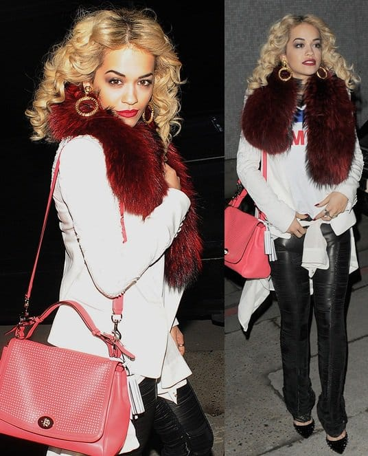 Rita Ora leaves a recording studio while decked in a colored fur scarf and leather pants