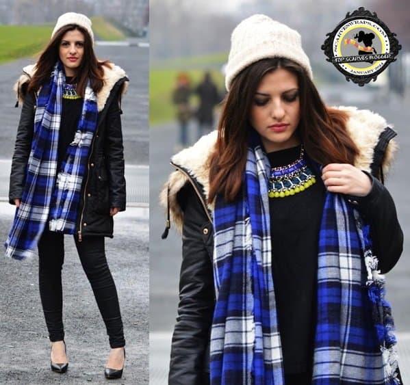Hannah wears a beautiful blue tartan scarf