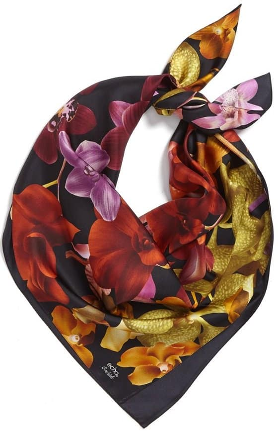A vivacious floral print lends a breezy, tropical vibe to a sophisticated silk scarf