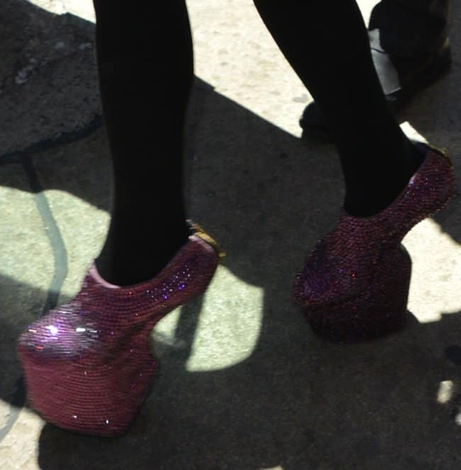 Daphne Guinnes wearing glittery heel-less shoes