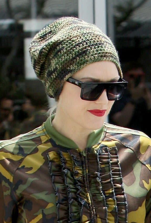 Gwen Stefani wearing a camo-patterned knitted beanie to match her camo-printed jacket