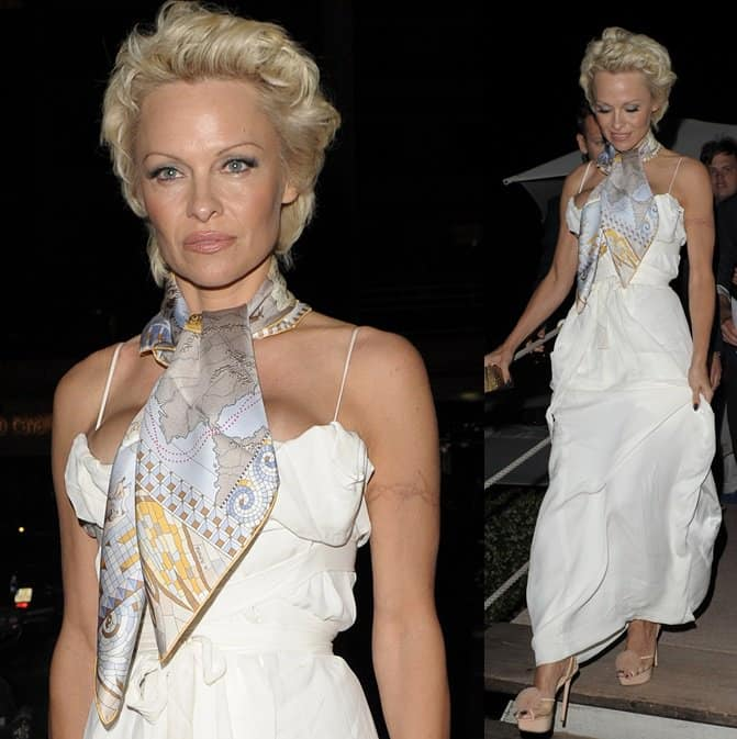 Pamela Anderson wearing a long white dress with a neckerchief