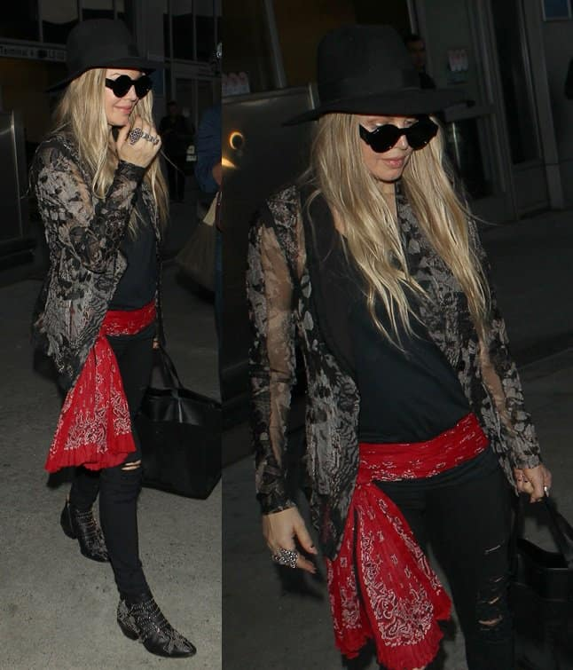 Fergie aka Stacey Ferguson and husband Joshua Duhamel at Los Angeles International Airport (LAX)