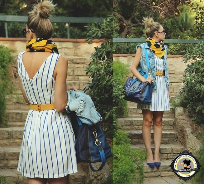 Priscila B. of My Showroom Blog styles her striped dress by wrapping a poppy printed yellow scarf around her neck