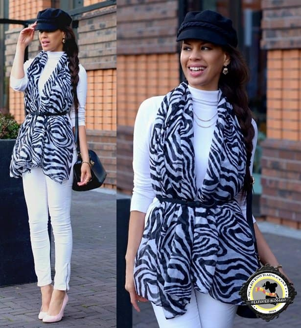 Tamara spices up her all-white outfit with a belted scarf vest