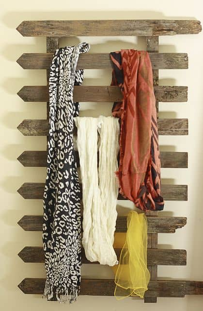 Turn an old scrap of fence into a scarf organizer