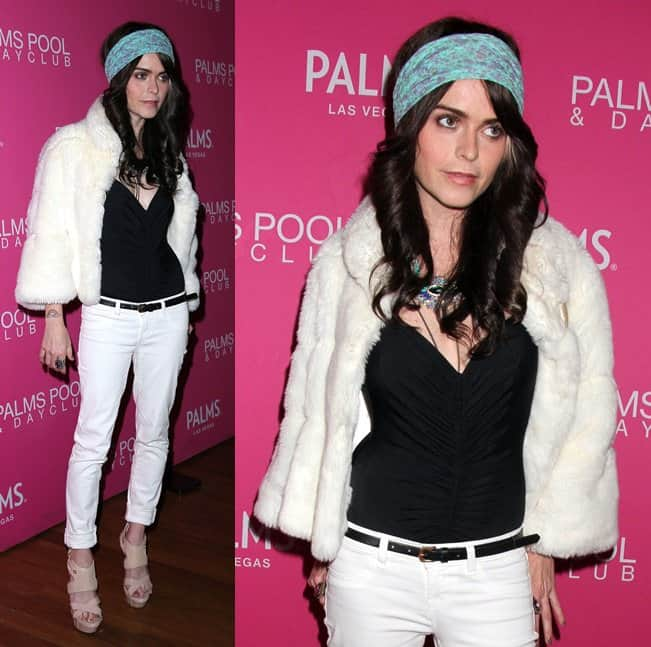 Taryn decked herself in black-and-white separates consisting of a black tank top worn under white skinny jeans and a white fur jacket