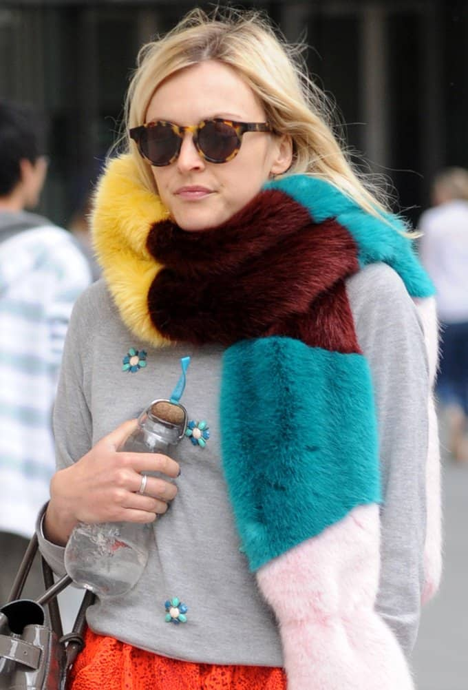 Fearne Cotton bundles up in bright pieces teamed with grey and black neutrals while on her way to Radio 1 studios in London on August 21, 2014