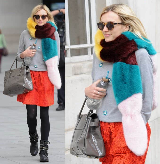 Fearne Cotton wore the busy extra with a beaded grey sweater, a bright orange lace skirt, and a pair of studded boots