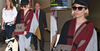 Sienna Miller Fails to Impress with Her Burberry Blanket Wrap