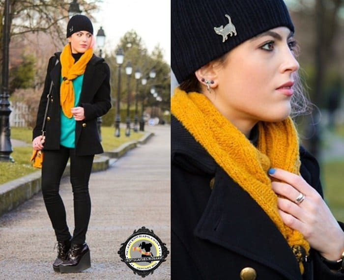 Marta brightened up her outfit with a yellow scarf
