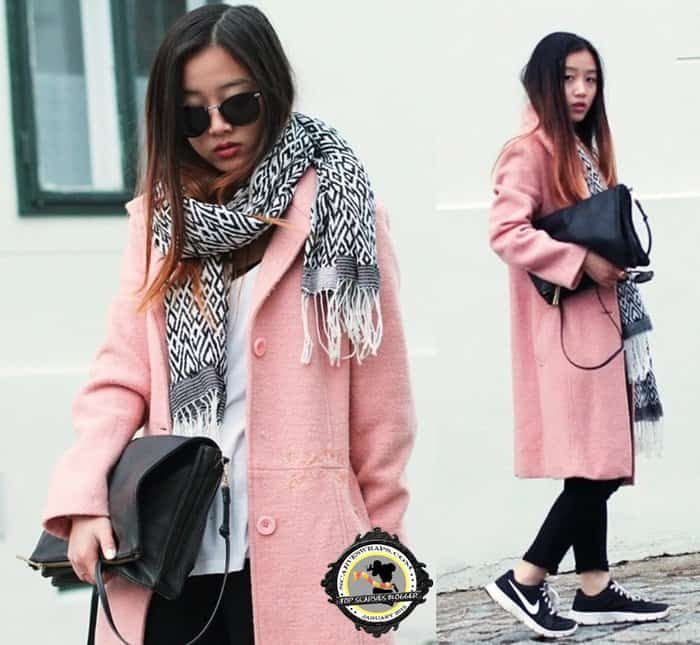 Trang rocks a geometric black-and-white scarf with a pink coat