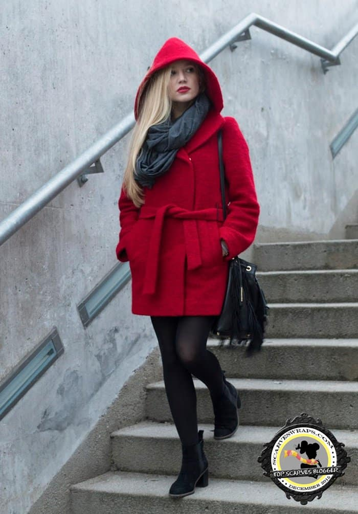 Ewa looking stylish in black stockings and a red coat