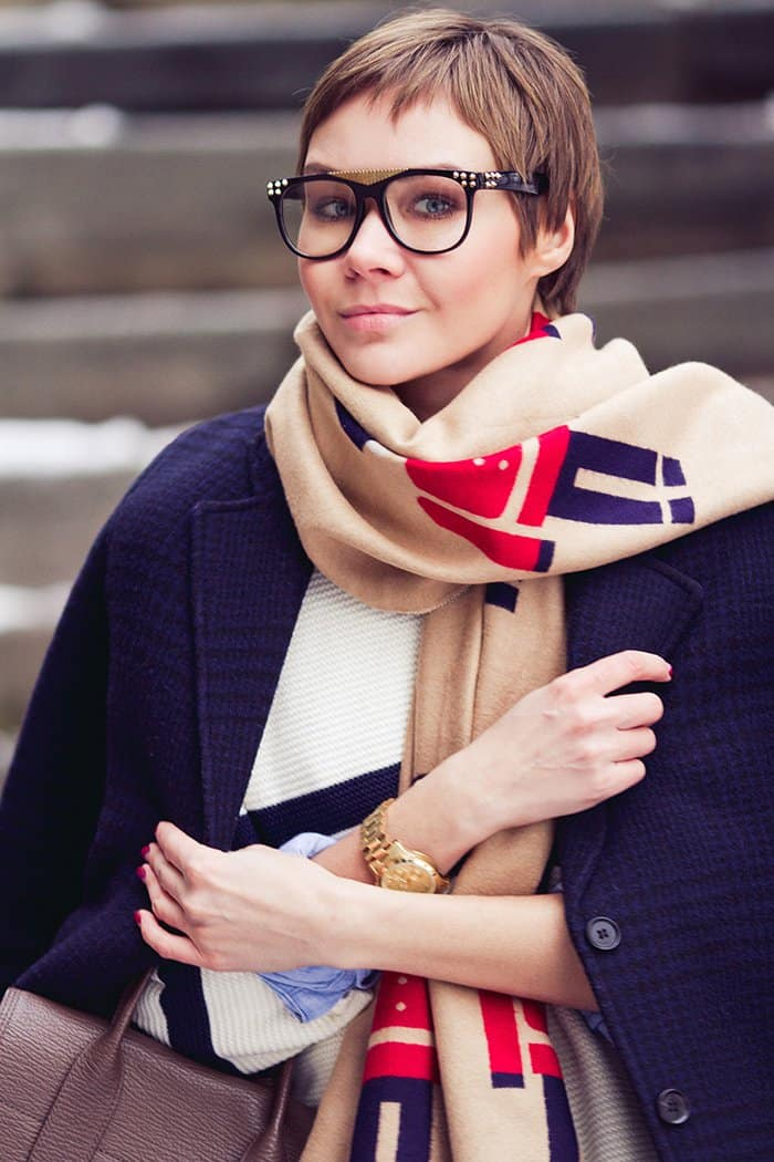 Lidia wears trendy glasses with her chic scarf