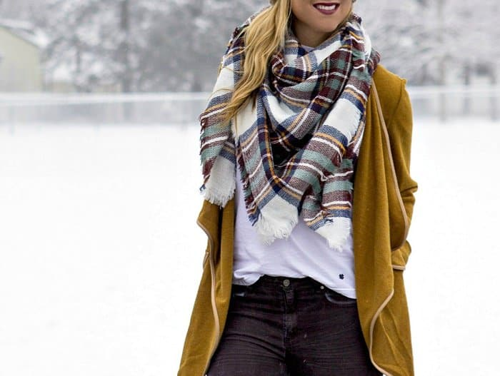 Rachel shows how to wear a plaid scarf in winter